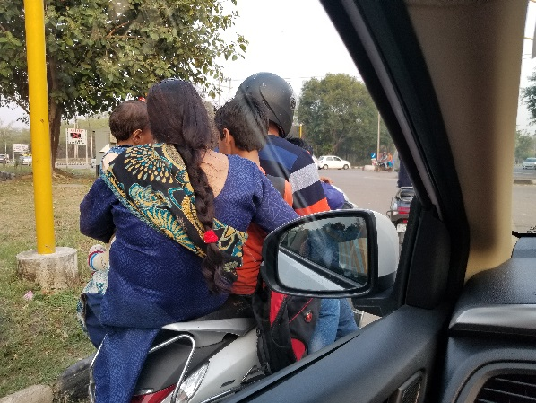 Indian family on scooter